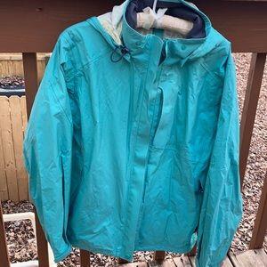 REI mint green rain jacket